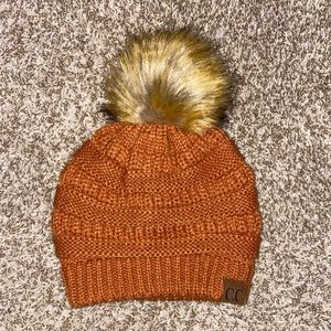 CC beanie Pom Pom hat. Rust colored